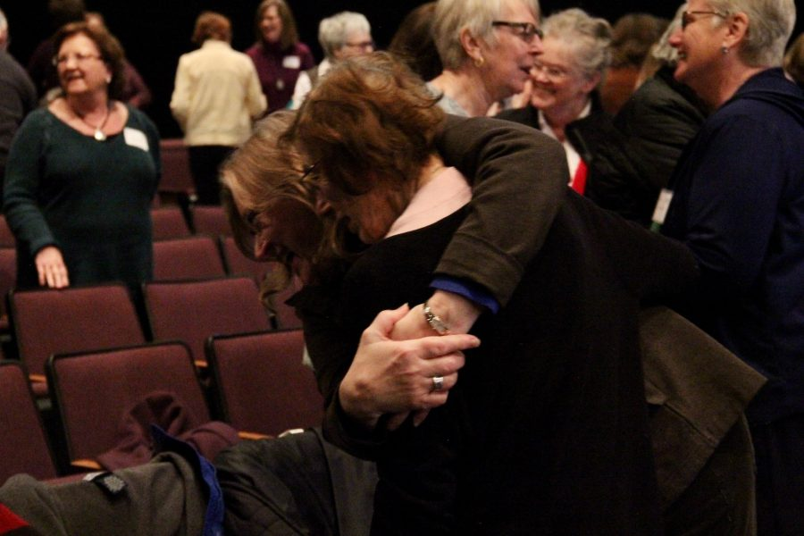 Two women embrace at the Joy Conference