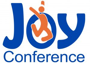 "An orange stick figure leaps through the letter ""O"" in the word ""Joy"" above the word ""Conference"""