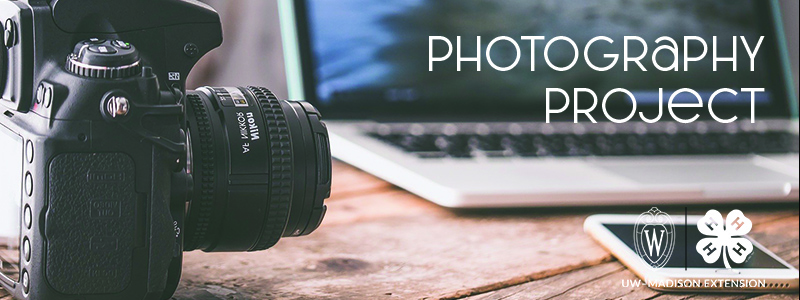 """A camera and the words """"Photography Project"""""""